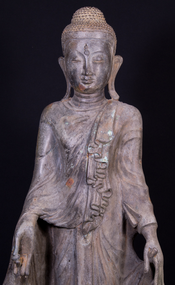 Old standing bronze Buddha statue from Burma made from Bronze