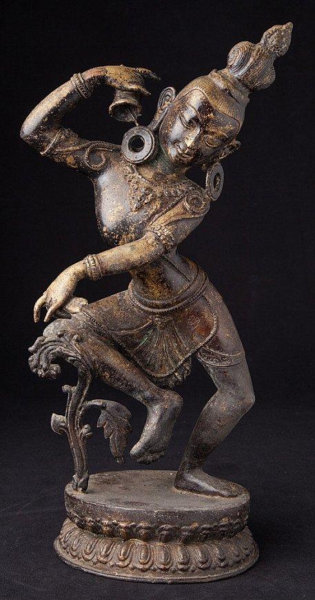 Old bronze dancing Dakini statue