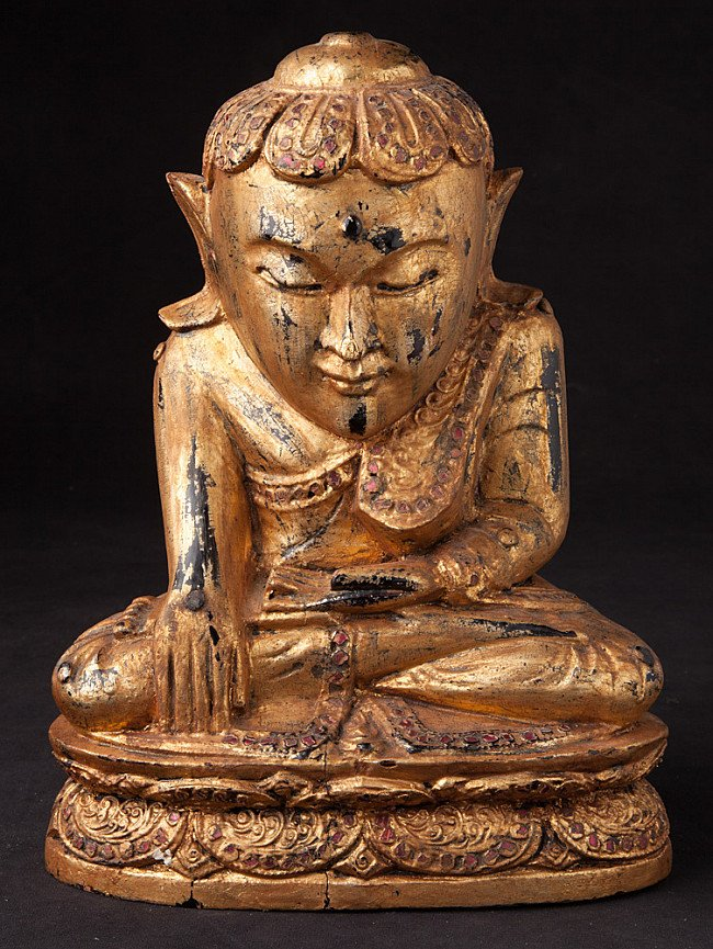 Old wooden Lotus Buddha statue