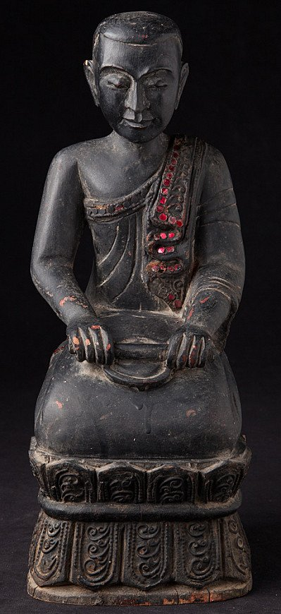 Old wooden Burmese Nun statue