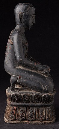 Old wooden Burmese Nun statue