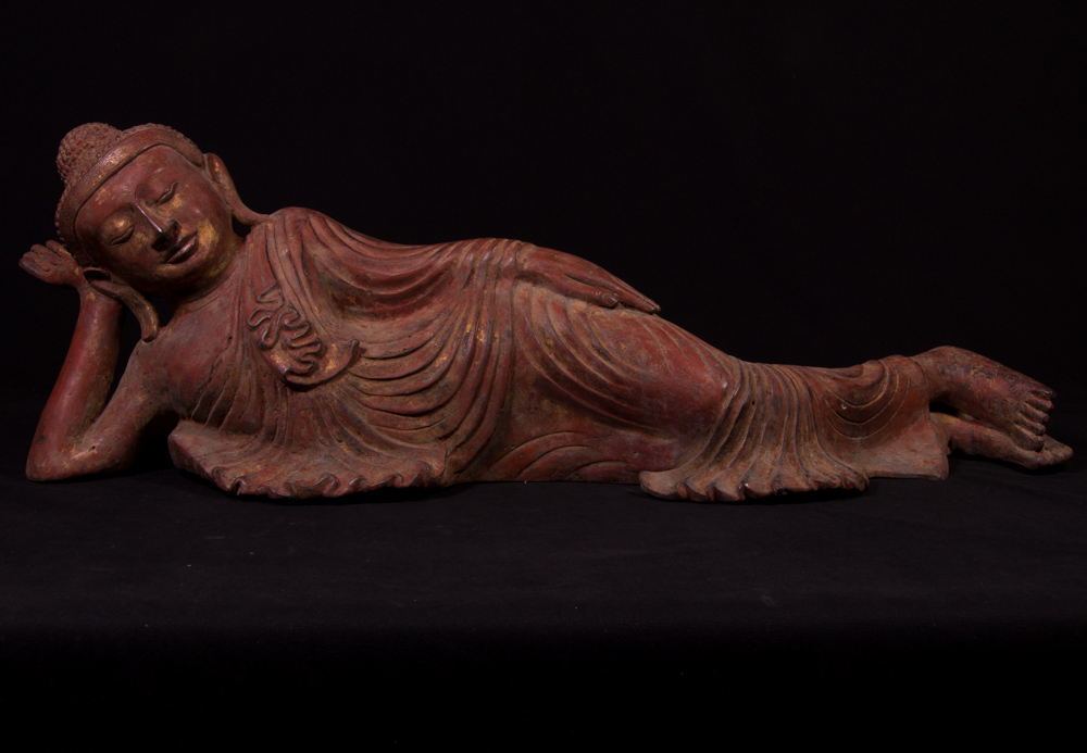 Old bronze reclining Buddha statue from Burma