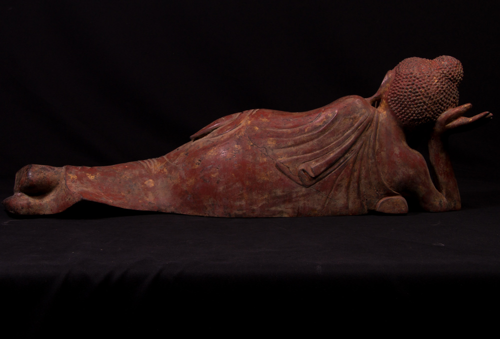 Old bronze reclining Buddha statue from Burma made from Bronze
