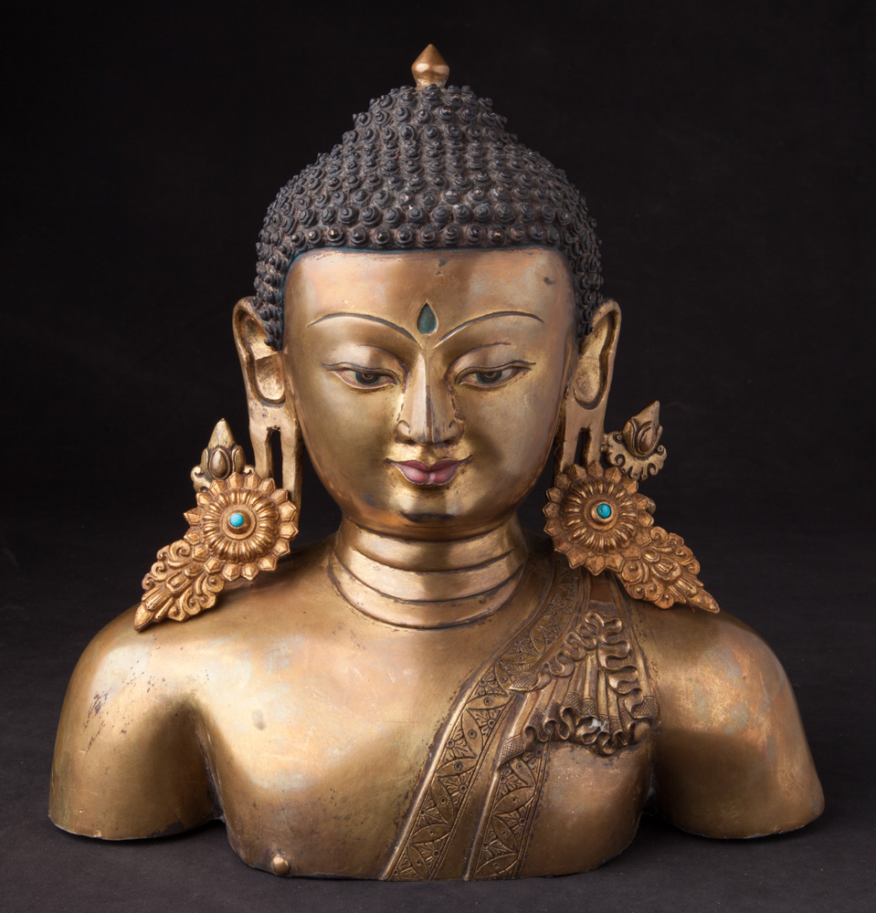 Old bronze Nepali Buddha head from Nepal