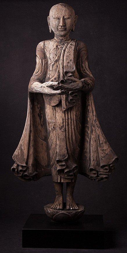 Antique wooden Monk statue