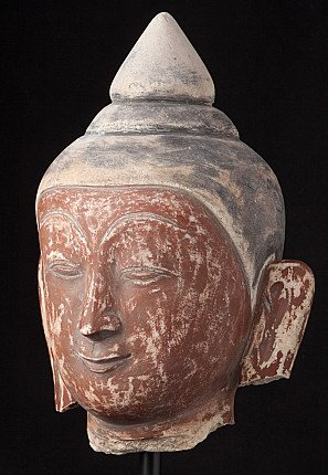 Large old marble Buddha head
