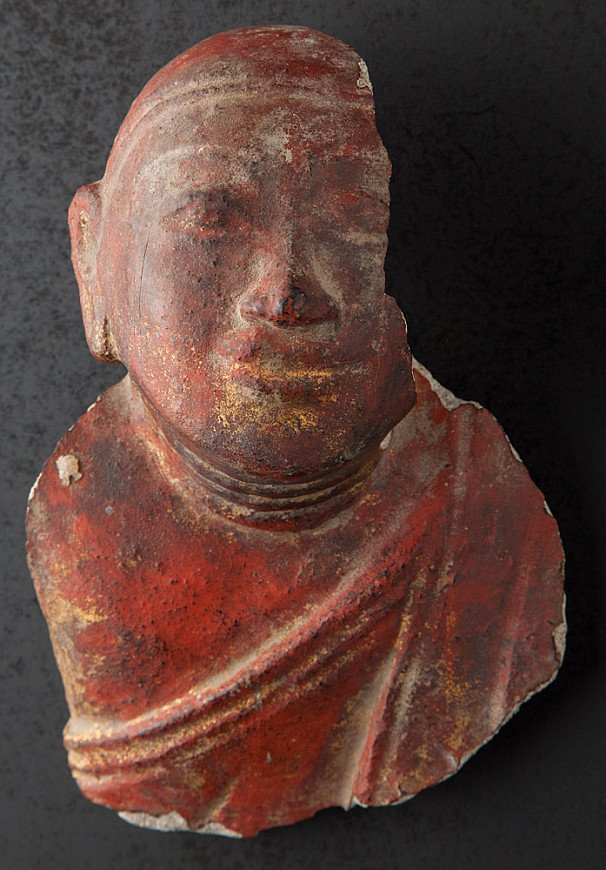 Fragment of sandstone Monk head