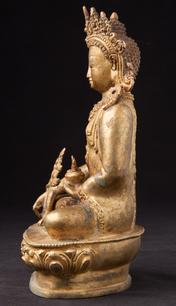 Old crowned Medicine Buddha statue from Nepal made from Bronze