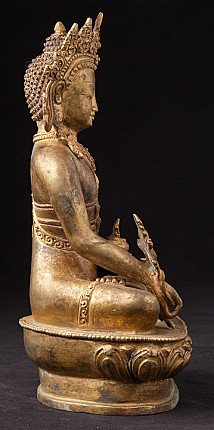 Old crowned Medicine Buddha statue