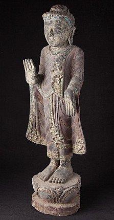 Old standing Buddha statue