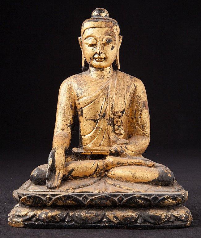 Old Burmese wooden Buddha statue
