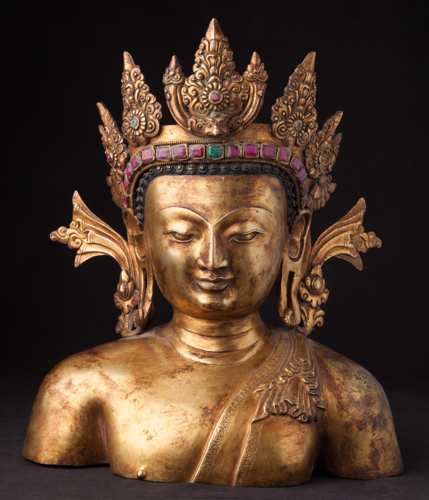 Old bronze Nepali Buddha head from Nepal made from Bronze