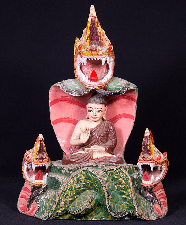 Old Burmese Buddha statue on Naga snake