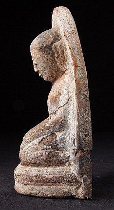 Antique pottery monk statue