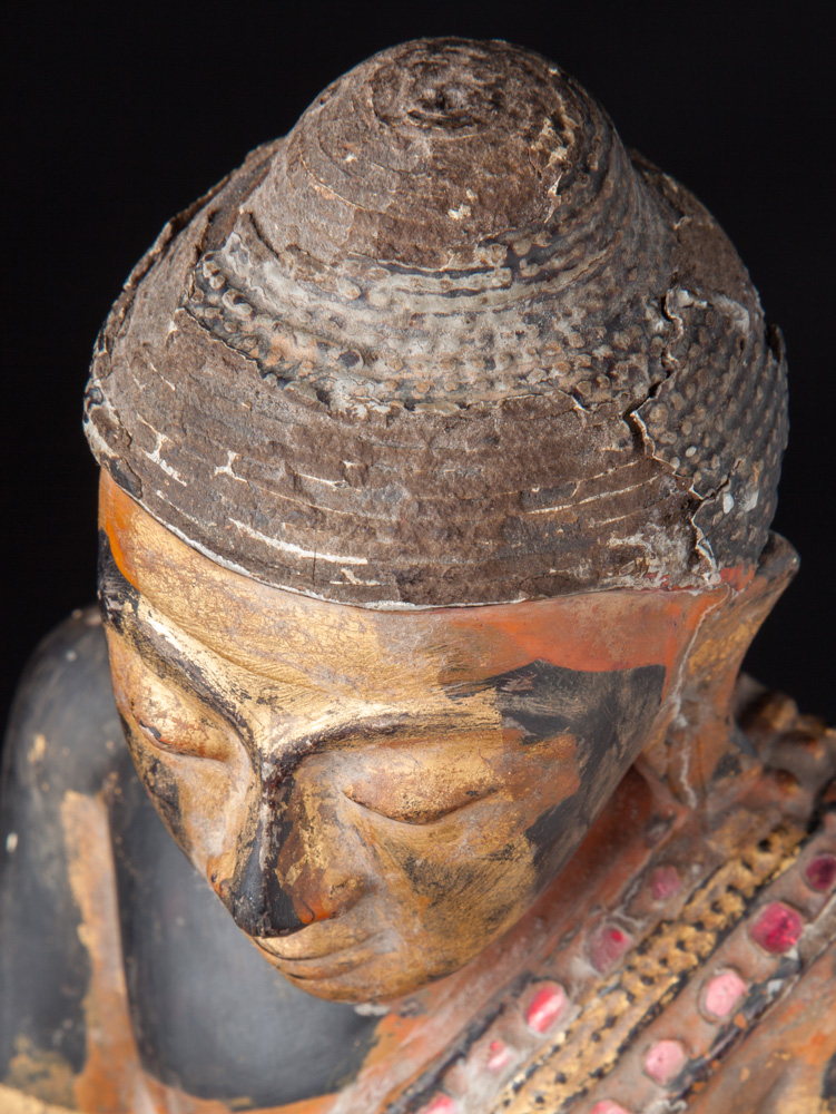 Old wooden Buddha statue on base from Burma made from Wood
