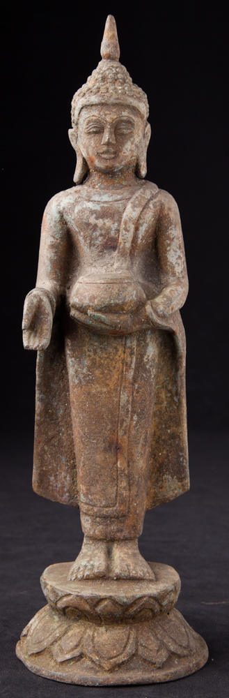 Old standing bronze Buddha statue from Burma