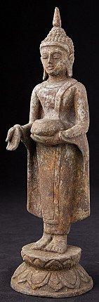 Old standing bronze Buddha statue