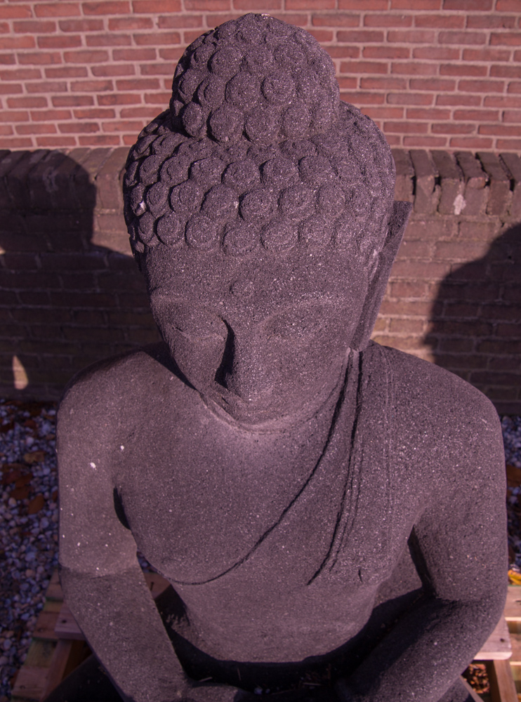 Old lavastone Buddha statue from Indonesia made from