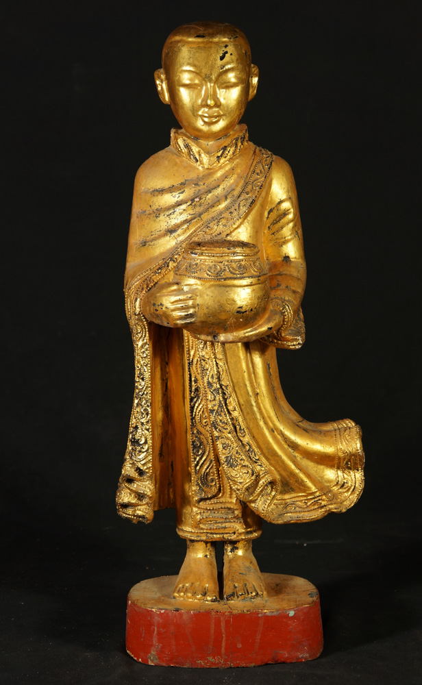 Old wooden monk statue from Burma