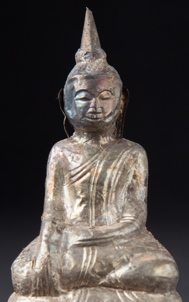 Antique silverplated Buddha statue from Burma made from Silverplated around a clay core