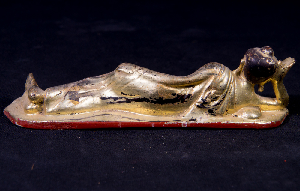 Antique reclining Buddha statue from Burma made from Wood