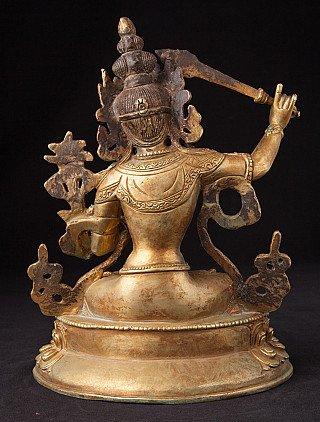 Old bronze Manjusri statue