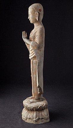 Old bronze standing monk statue