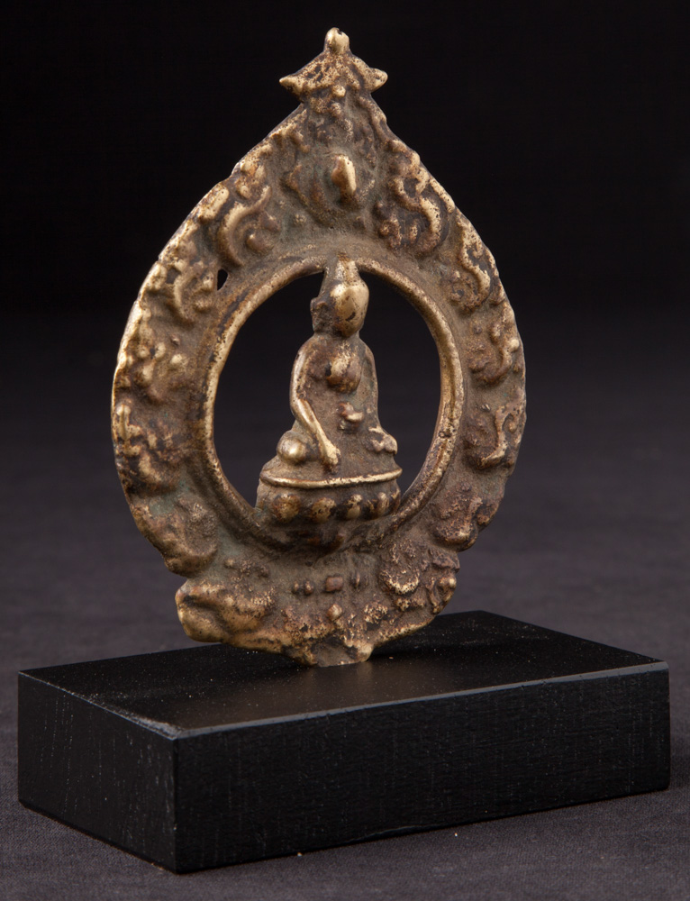Antique Nepali Buddha statue on base from Nepal made from Bronze