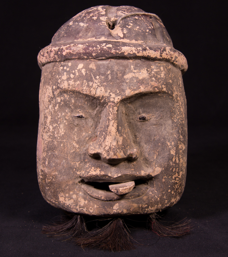 Old head of Burmese puppet from Burma