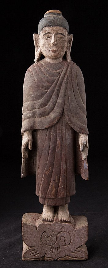 Antique wooden Mon style Buddha statue