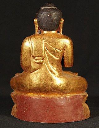 Newly made wooden Buddha statue