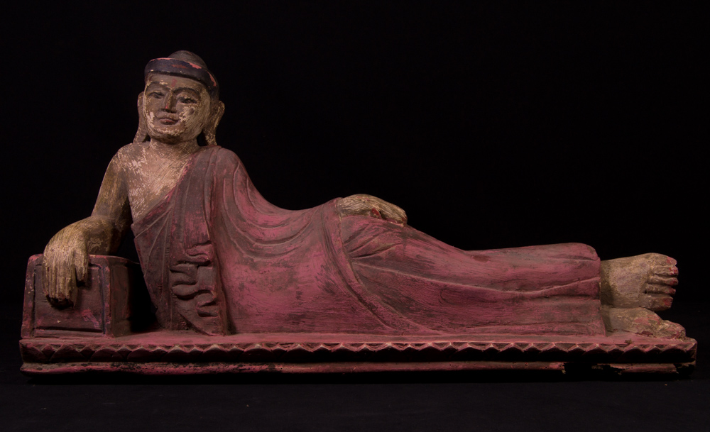 Old lacquerware reclining Buddha statue from Burma made from lacquer