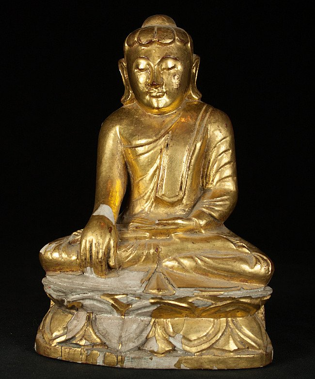 Old wooden Lotus Buddha statue