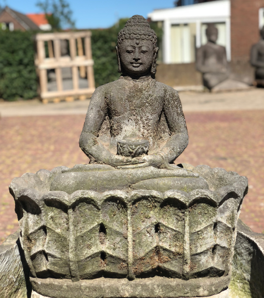 Large lavastone Buddha with fountain from Indonesia made from Lavastone