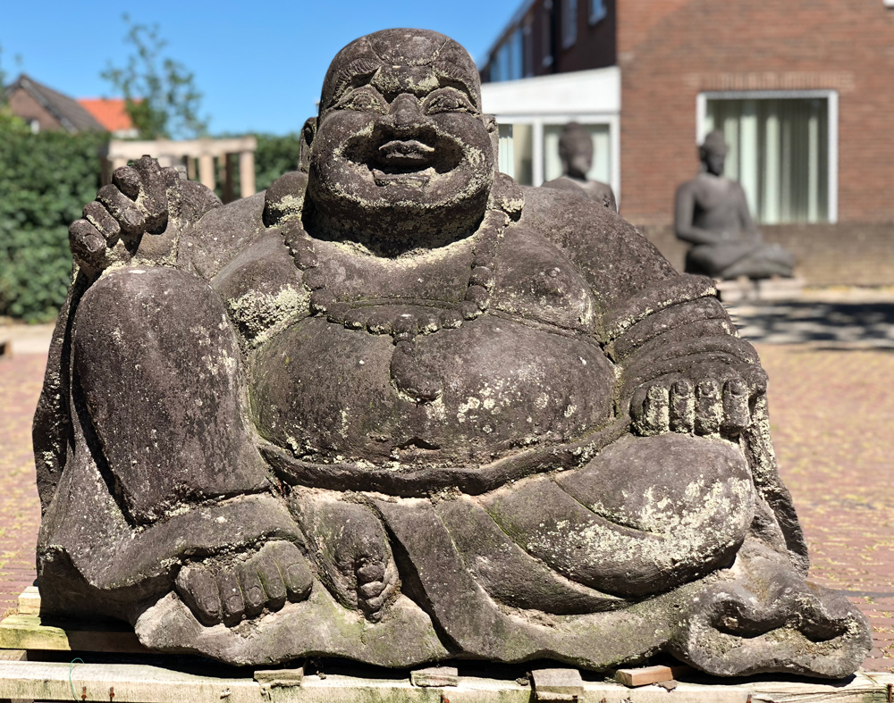 Large lavastone Happy Buddha statue from Indonesia made from Lavastone