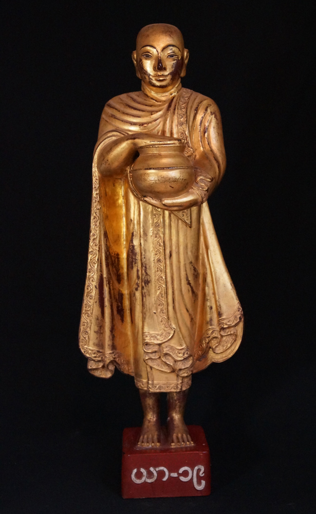 Antique wooden Burmese monk statue from Burma