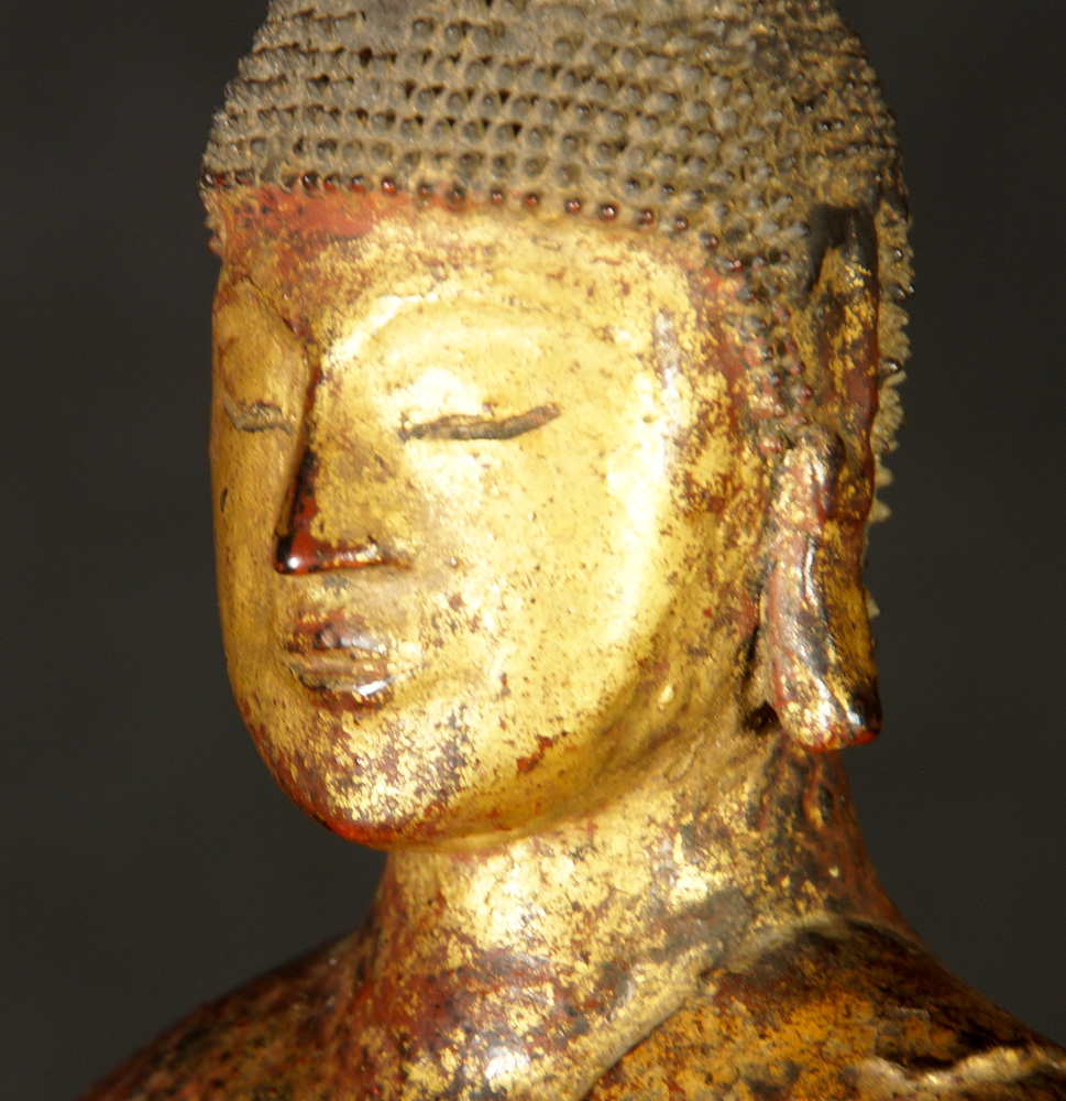 Antique wooden Laos Buddha statue from Laos, made from wood