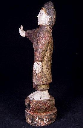 Antique standing Buddha statue