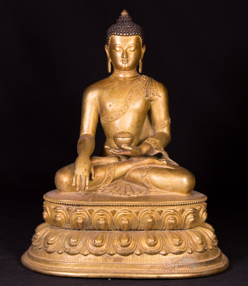Old bronze Buddha statue from Nepal