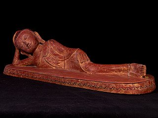 Old lacquerware reclining Buddha statue