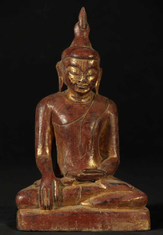 Old wooden Ava style Buddha statue from Burma
