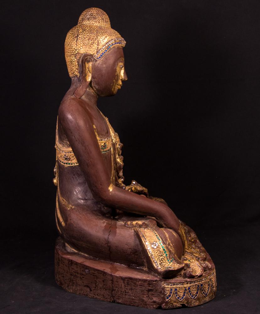 Old wooden Mandalay Buddha statue