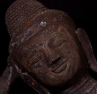 Old bronze reclining Buddha statue