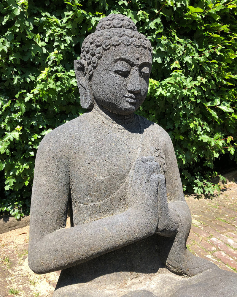 Old lavastone Buddha statue from Indonesia made from Lavastone