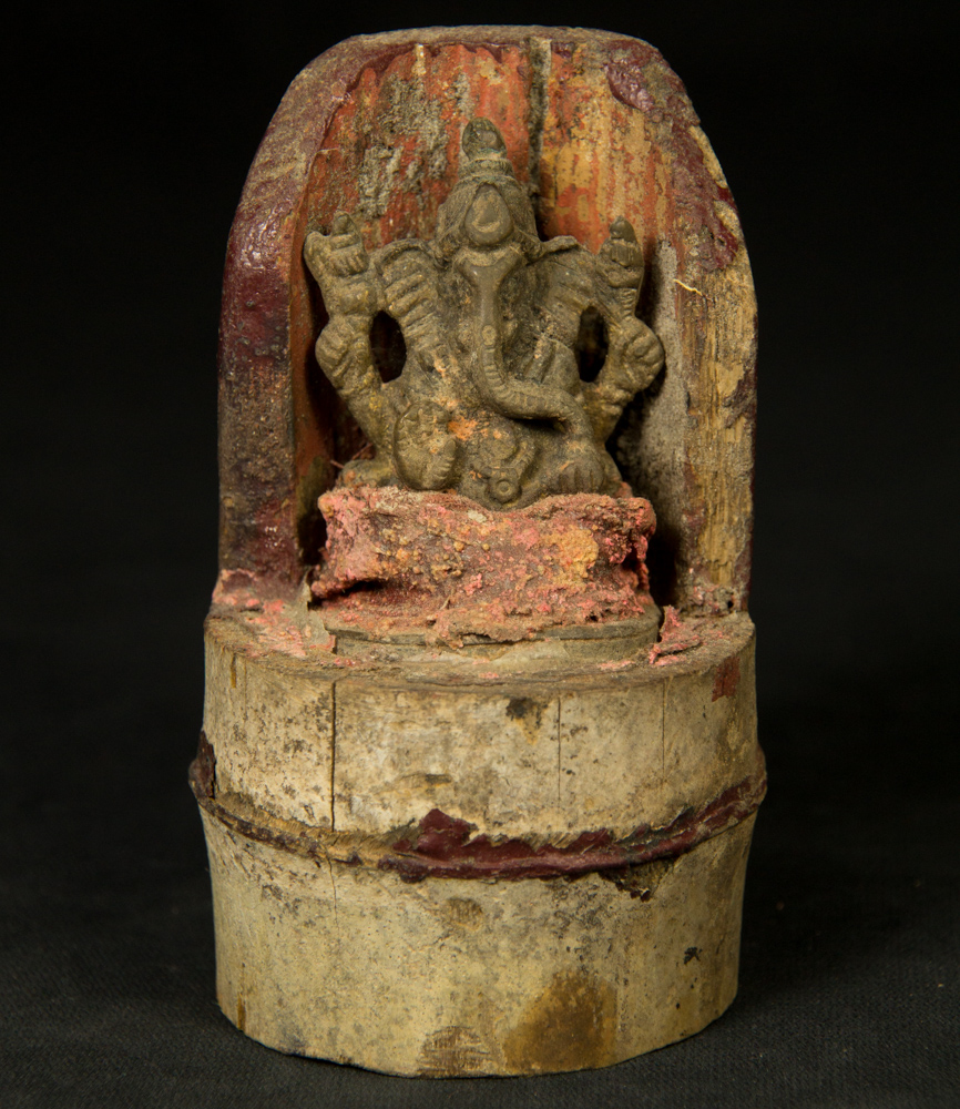 Old Ganesha on bamboe from Nepal made from Bronze