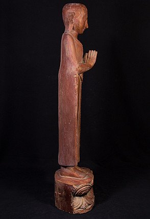 Old wooden monk statue
