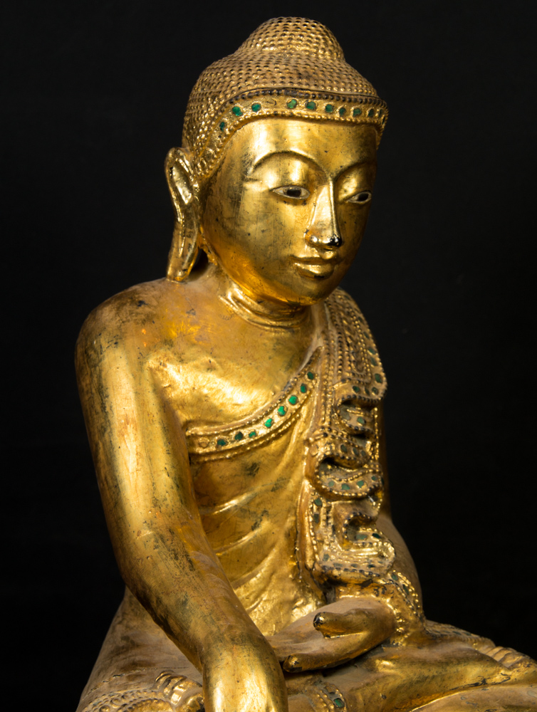 Old Burmese Mandalay Buddha statue from Burma made from Wood
