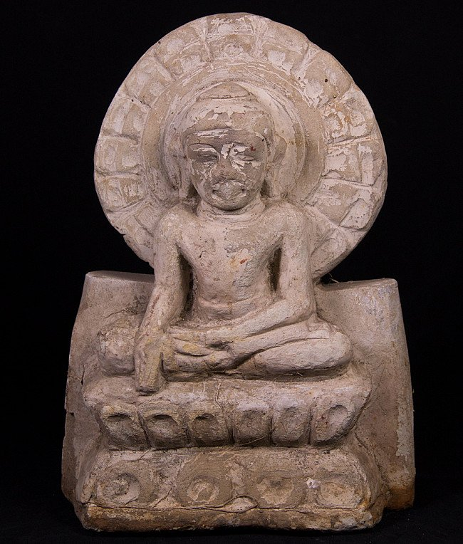Antique stone Buddha statue