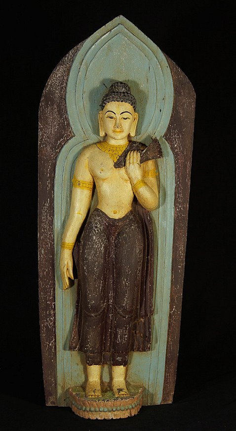 Old wooden Buddha panel