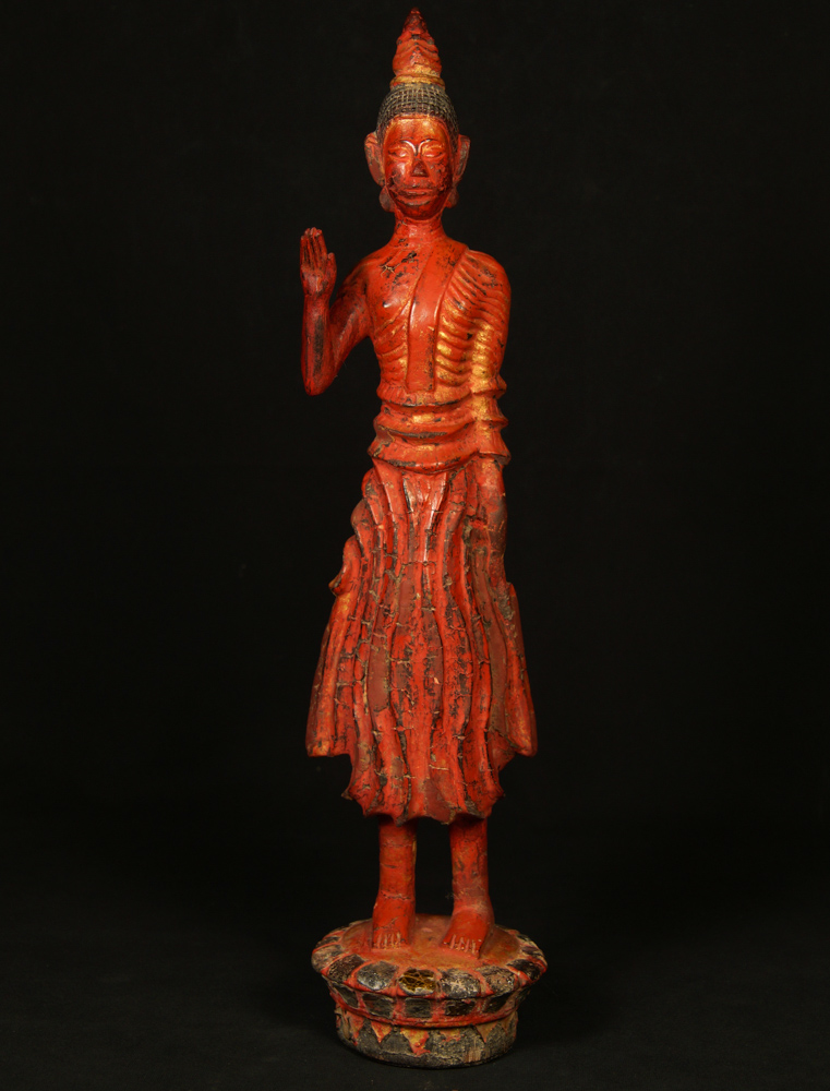 Antique standing Laos Buddha statue from Laos